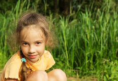 Healthy Smiling Girl in Green Grass. Stock Photos