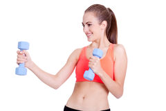 Healthy smiling girl workout with dumbbell Royalty Free Stock Photo