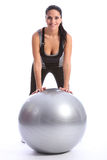 Healthy smiling woman with fitness exercise ball Royalty Free Stock Image