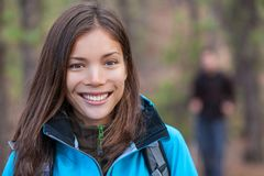 Healthy smiling woman hiking outdoors royalty free stock photo