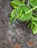 Healthy smoothie fresh green spinach leaves Detox concept. Healthy smoothie fresh green spinach leaves. Food ingredients. Detox concept. Top view, selective Royalty Free Stock Images