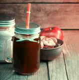 Healthy smoothie in glass jar on rustik wood stock photo