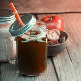 Healthy smoothie in glass jar on rustik wood royalty free stock image