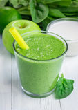 Healthy smoothie with green apple, spinach, lime and coconut milk Royalty Free Stock Photos