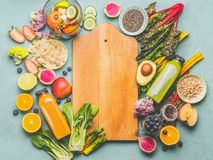 Healthy smoothie ingredients around wooden cutting board, top view. Summer food and beverages background. Vegan superfood: Fruits. Berries and vegetables, chia stock photos