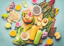 Healthy smoothie ingredients and mix blender on kitchen table, top view. Summer food and beverages background. Vegan superfood:. Fruits, berries and vegetables royalty free stock photo