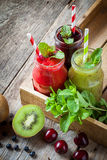 Healthy smoothie from kiwi, raspberries and blueberries Royalty Free Stock Images