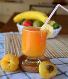 Healthy smoothie with orange, banana and apricot on a glass Royalty Free Stock Photos