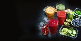 Different types of smoothies on black background.