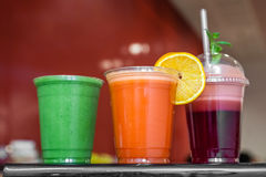 Healthy smoothies. Strawberry, raspberry, orange, kiwi and avocado smoothies in plastic recyclable cups stock photo