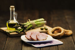 Healthy snack. Cured meat bread asparagus and olive oil Stock Image