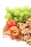 Healthy snack. Pile of cereals and fresh nectarines and grapes close-ups Royalty Free Stock Images