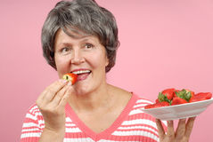 Healthy snack. Of sun-ripened strawberries Stock Photo