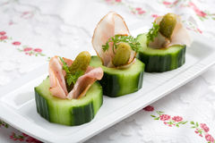 Healthy snack. Small snack with cucumber, gurkin and ham rolled into one Royalty Free Stock Image