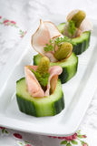 Healthy snack. Delicious and healthy snack with cucumber, ham and gherkin Royalty Free Stock Photos