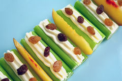 Healthy Snack. Healthy afternoon snack of celery sticks with cream cheese and sultanas Stock Photos
