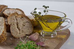 Healthy snack. Cereals bread, olive oil with herb spicy and garlic. Fresh cress salad. Stock Image