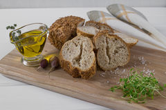 Healthy snack. Cereals bread, olive oil with herb spicy and garlic. Fresh cress salad. Royalty Free Stock Photos