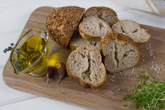 Healthy snack. Cereals bread, olive oil with herb spicy and garlic. Fresh cress salad. Stock Photography