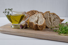 Healthy snack. Cereals bread, olive oil with herb spicy and garlic. Fresh cress salad. Stock Images