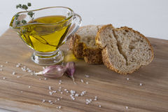 Healthy snack. Cereals bread, olive oil with herb spicy and garlic. Stock Photo