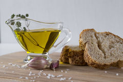 Healthy snack. Cereals bread, olive oil with herb spicy and garlic. Stock Photography