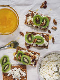 Healthy snack with cheese cottage, kiwi and honey Stock Photography