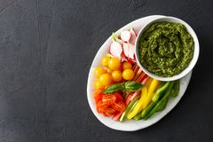 Healthy snack Raw vegetables pesto sauce with copy space Vegetar Stock Photography