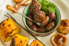Healthy snack of dried figs, olives, nuts and roasted maize. Stock Image