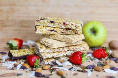 Breakfast Granola Bars with Strawberries. Healthy snack. Fitness. Dietary food. Cereal granola bars with nuts ,cocoa beans and coconut royalty free stock photography