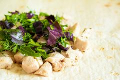 Healthy snack, fitness lunch. Cooking wrapped sandwich gyros – royalty free stock images