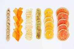 Healthy snack. Homemade dehydrated fruit chips on white background. Dry orange, grapefruit, mango, banana, kiwi. Diet food. Healthy snack. Homemade dehydrated stock photos