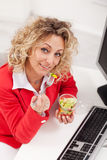 Healthy snack at the office. Woman eating fresh vegetables mix Stock Image