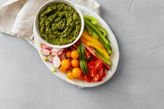 Healthy snack Raw vegetables pesto sauce copy space top view Veg Stock Image