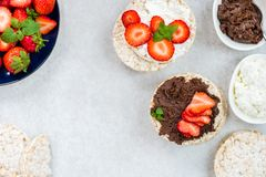Healthy Snack from Rice Cakes with Hazelnut Spread, Ricotta Chee royalty free stock photography