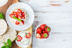 Healthy Snack from Rice Cakes with Ricotta and Strawberries. On Light Wooden Background Royalty Free Stock Image