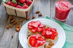Healthy snack small loafs with peanut butter and fresh strawberr Stock Photo