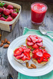 Healthy snack small loafs with peanut butter and fresh strawberr Stock Photography