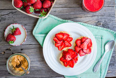 Healthy snack small loafs with peanut butter and fresh strawberr Stock Images