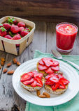 Healthy snack small loafs with peanut butter and fresh strawberr Royalty Free Stock Images