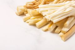 Healthy Snack. Smoked string cheese. Kobarcik. Selective focus stock photography