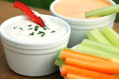 Healthy snack. Vegetable sticks and dips in bowls royalty free stock image
