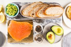 Healthy Snack with Wholemeal Bread Toasts, Avocado and Salmon. Table settings for the Healthy Snack with Wholemeal Bread Toasts, Avocado and Salmon Royalty Free Stock Photos