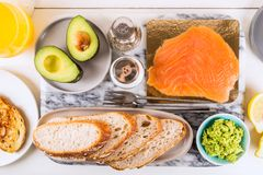 Healthy Snack with Wholemeal Bread Toasts, Avocado and Salmon. Table settings for the Healthy Snack with Wholemeal Bread Toasts, Avocado and Salmon Royalty Free Stock Images