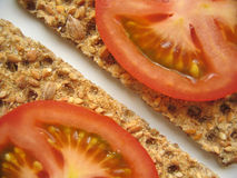 Healthy Snacks. Sliced tomato on crispbreads stock photos