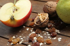 Healthy snacks. Some healthy fruit snacks in front of a wooden background Stock Image