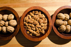 Healthy snacks. Image of some almonds and walnuts Royalty Free Stock Photography