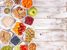Healthy snacks on wooden table with copy space Royalty Free Stock Images