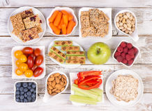 Healthy snacks on wooden table Stock Photography