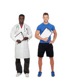 Healthy soport. Personal trainer and african doctor Royalty Free Stock Photo